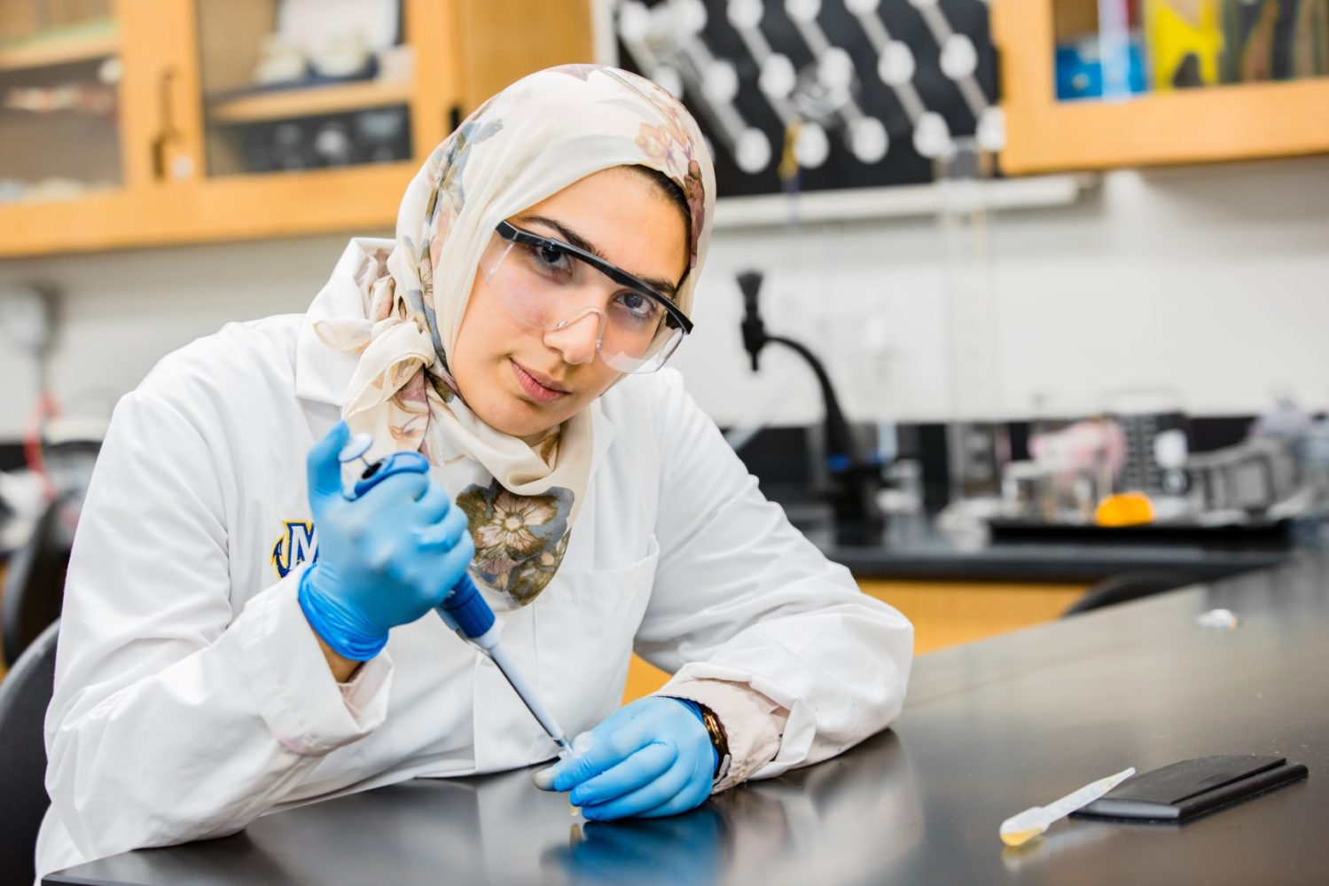 female student with headscarf in lab