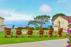 Adirondack chairs overlooking the ocean