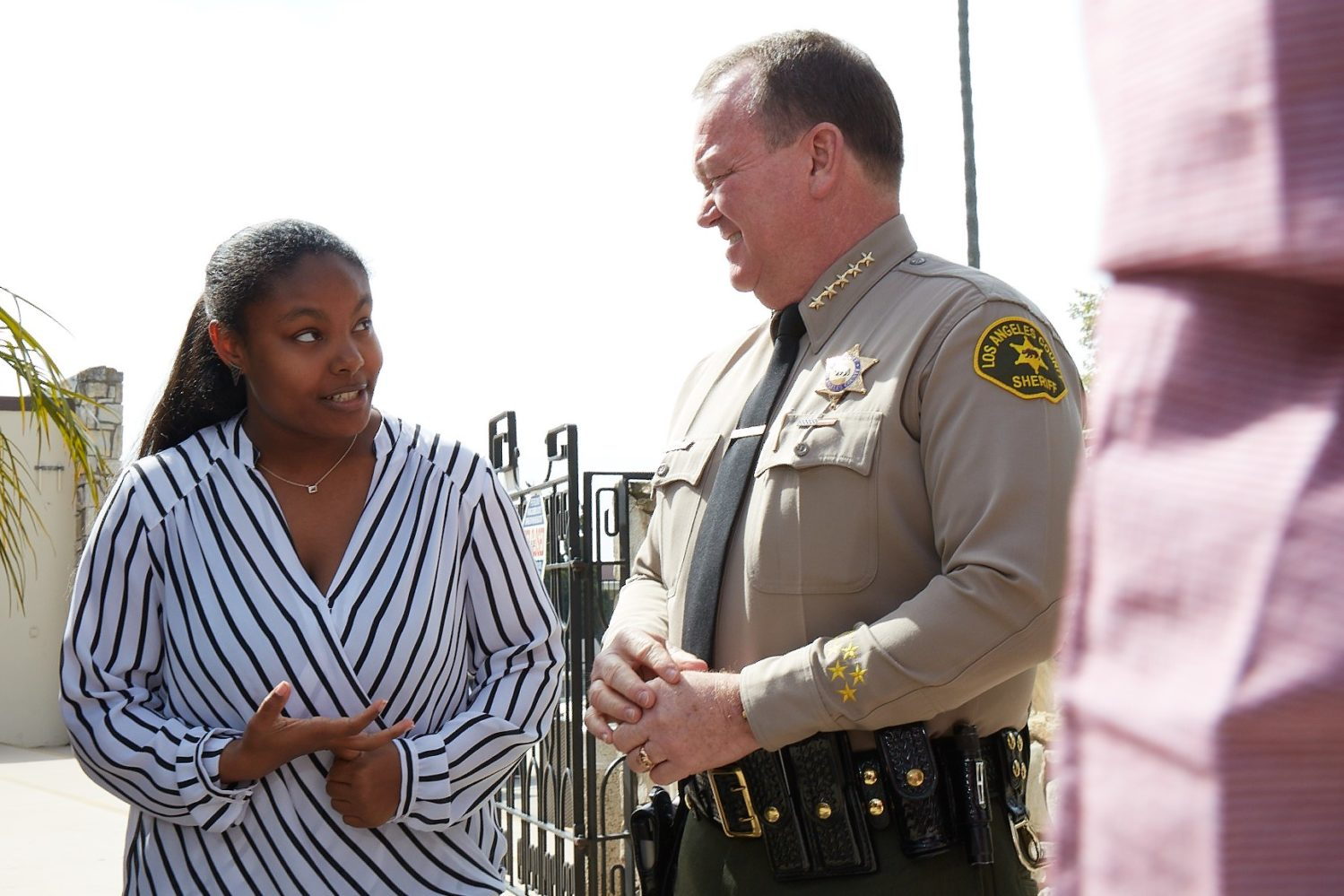 Criminal Justice student speaking with LA County Sherrif