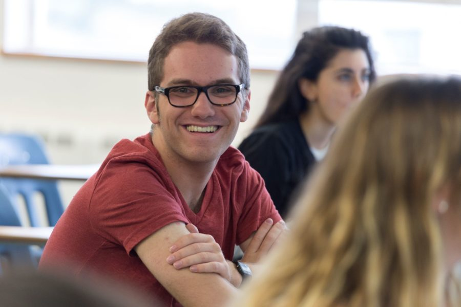 happy male student in classroom