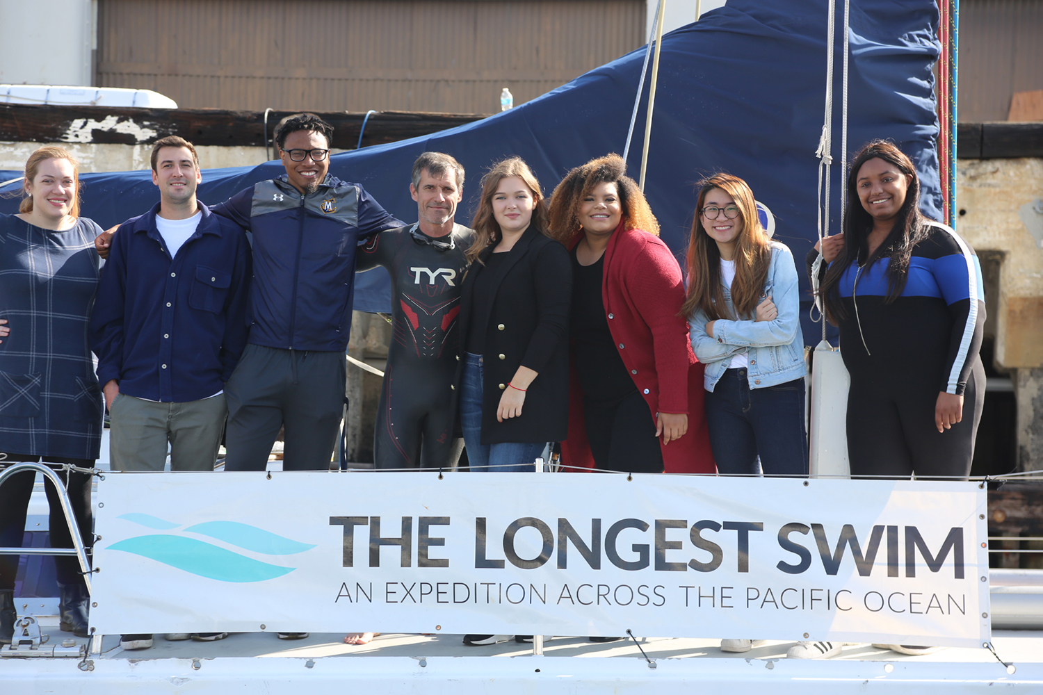 Student interns on the Longest Swim sailboat