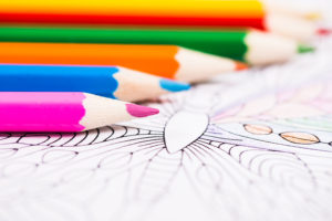 colored pencils and coloring book
