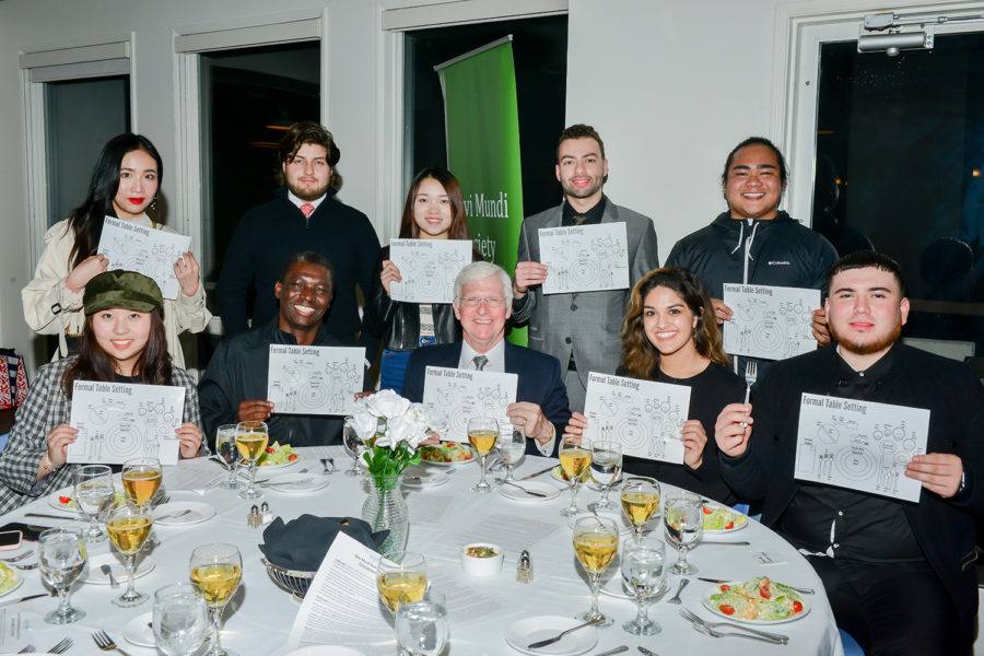 students and faculty at academic society dinner