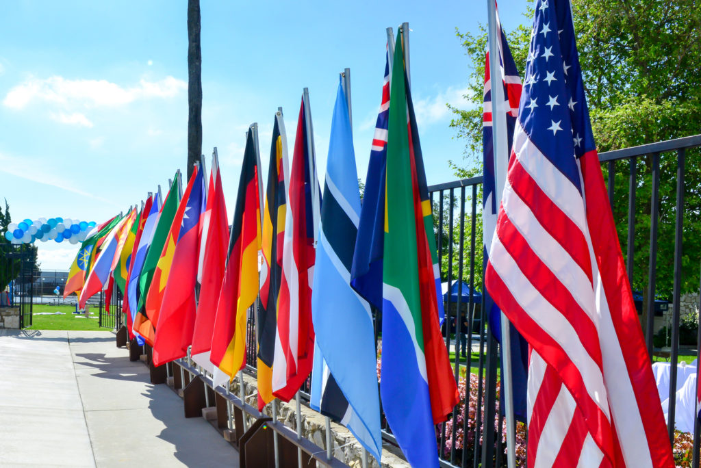 flags from different countries displayed on campus